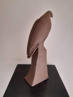 Buse solitaire de dos sculpture 1 de trilogie a bec